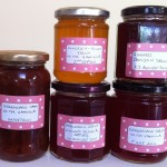 A collection of jars containing different jams and jellies