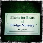 A sign pointing to a plant nursery