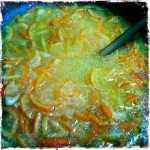 Seville orange juice and peel soaking in a bowl