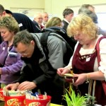 Visitors browsing seeds at the seed swap table